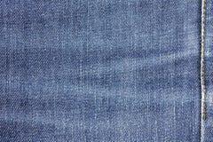 Fond de texture de tissu de jeans de denim avec la couture pour la conception Photos libres de droits