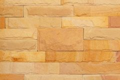 Fond de texture moderne de mur de briques en pierre, mur abstrait de sable ou mur de granit Photos stock
