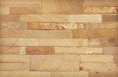 Fond de texture moderne de mur de briques en pierre, mur abstrait de sable ou mur de granit Photo libre de droits