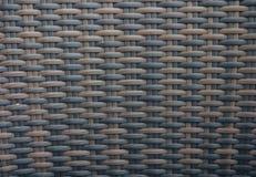 Fond de texture de rotin Donnez au plastique une consistance rugueuse brun en osier photographie stock libre de droits