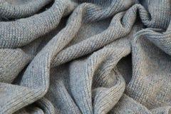 Fond de toile grise tricotée de la laine du ` s de chèvre faite avec le knitti Images libres de droits