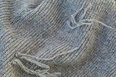 Fond de toile grise tricotée de la laine du ` s de chèvre faite avec le knitti Photographie stock