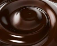 Fond de tourbillonnement de chocolat Images libres de droits
