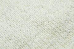 Fond de tricotage blanc de texture de laine Photographie stock libre de droits