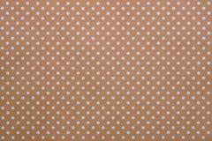Fond de vintage de Brown dans des points de polka Photos stock