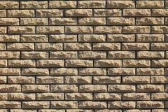 Fond des briques de revêtement jaunes Image stock