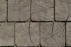 Fond des cabanes en rondins en bois carrées Photographie stock libre de droits
