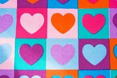 Fond des coeurs colorés : impression de tissus. Photo stock
