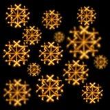 Fond des flocons de neige faits avec des cierges magiques sur le noir Photo libre de droits
