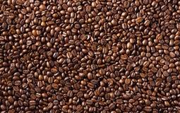 Fond des graines de café frites macro Photos libres de droits
