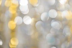 Fond des lumières fortement brouillées des guirlandes photos stock