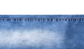 Fond des morceaux de jeans sur le blanc Photographie stock libre de droits