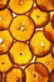 Fond des oranges coupées en tranches Photos libres de droits
