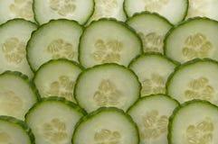 Fond des parts de concombre Photo libre de droits