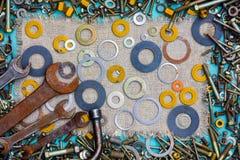 Fond des pièces et des outils Photographie stock