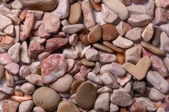 Fond des pierres de mer dans un plan uniforme Photographie stock