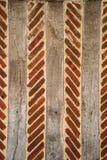 Fond du 18ème siècle de mur de brique et en bois Photo stock