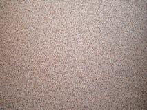 Fond du gravier dispersé d'amende de sable Texture d'une surface en pierre, plan rapproché Miette d'or Images stock