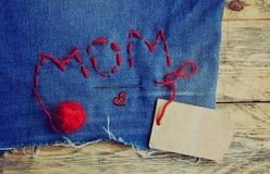 Fond du jour de mère, tissu de jeans Images stock