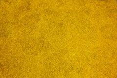 Fond du revêtement caoutchouté utilisé sur le jaune des enfants et des au sol de sports photos stock