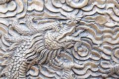 Fond en acier chinois de modèle de visage de dragon Images stock