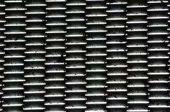 Fond en acier de modèle de trous ovale dans la couleur noire photographie stock