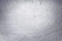 Fond en aluminium de texture en m?tal, ?raflures sur l'acier inoxydable poli photographie stock libre de droits