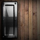 Fond en bois avec l'élément en métal Images libres de droits
