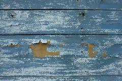 Fond en bois avec la peinture d'épluchage Photographie stock libre de droits