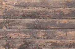 Fond en bois de Brown avec des clous Photographie stock libre de droits
