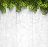 Fond en bois de Noël avec des branches de sapin Photos stock