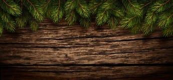 Fond en bois de Noël avec des branches de sapin Photographie stock