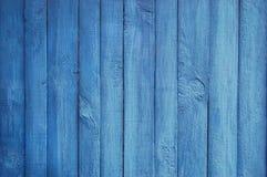 Fond en bois de palissade, peinture bleue Photo stock