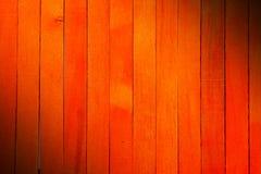Fond en bois de texture de cloison de séparation de couleur orange approximative de cru photo stock