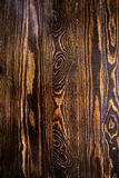Fond en bois de texture de mur de Brown avec les noeuds jaunes Image libre de droits