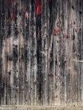 Fond en bois de vieux bois de construction rouge noir Images libres de droits