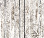 Fond en bois de vintage avec la boussole Images stock