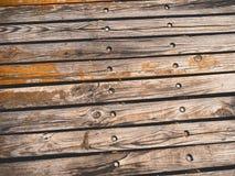 Fond en bois graveleux de texture de vieilles planches en bois Photos stock