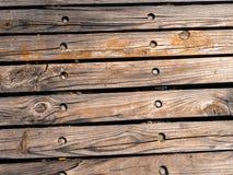 Fond en bois graveleux de texture de vieilles planches en bois Photo stock