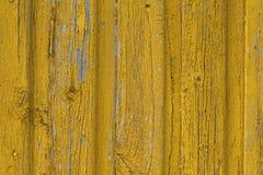 Fond en bois jaune de mur Image stock