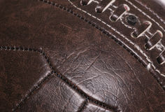 Fond en cuir du football de cru Photographie stock libre de droits