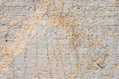 Fond en pierre avec les inscriptions grecques antiques Image libre de droits