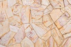 Fond en pierre brun de texture de mur de briques de plan rapproché dans le ton de vintage Photo libre de droits