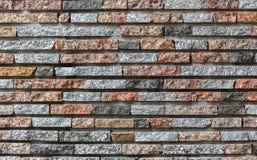 Fond en pierre coloré décoratif moderne de mur de briques photos stock