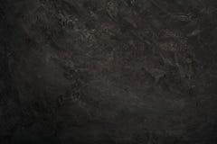 Fond en pierre noir abstrait Photographie stock libre de droits