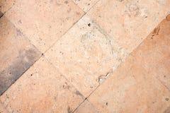Fond en pierre orange de texture de trottoir de bloc Image libre de droits