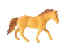 Fond en plastique de blanc d'isolat de jouet de cheval de Brown Photographie stock libre de droits
