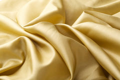Fond en soie d'or Images libres de droits