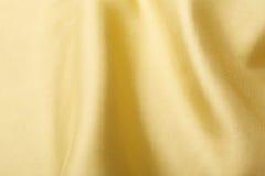 Fond en soie d'or Photographie stock