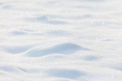 Fond ensoleillé de neige Photographie stock libre de droits